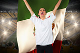 Football fan in white cheering holding mexico flag