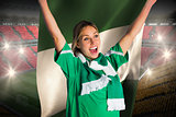 Cheering football fan in green jersey holding nigeria flag
