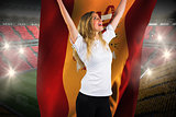 Pretty football fan in white cheering holding spain flag
