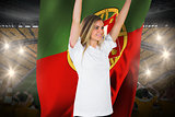 Pretty football fan in white cheering holding portugal flag