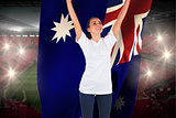 Excited football fan in white cheering holding australia flag