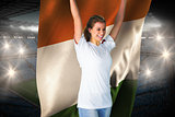 Pretty football fan in white cheering holding ivory coast flag