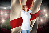 Pretty football fan in white cheering holding england flag