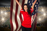 Cheering football fan in red holding usa flag