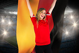 Cheering football fan in red holding germany flag