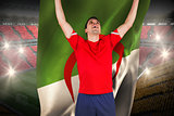 Excited football player cheering holding algeria flag