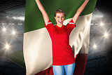 Cheering football fan in red holding italy flag