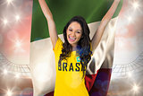 Excited football fan in brasil tshirt holding italy flag