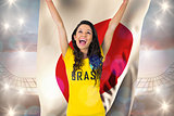 Excited football fan in brasil tshirt holding japan flag