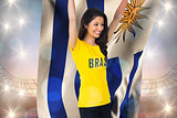 Excited football fan in brasil tshirt holding uruguay flag