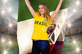 Excited football fan in brasil tshirt holding mexico flag
