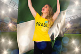 Excited football fan in brasil tshirt holding nigeria flag