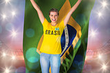 Excited football fan in brasil tshirt holding brasil flag