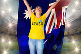 Excited football fan in brasil tshirt holding australia flag