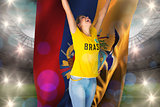 Excited football fan in brasil tshirt holding ecudaor flag
