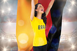 Excited football fan in brasil tshirt holding germany flag