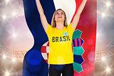 Excited football fan in brasil tshirt holding croatia flag
