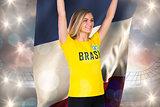Excited football fan in brasil tshirt holding france flag