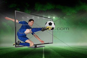 Fit football player kicking ball through tv