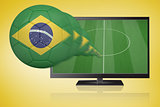 Football in brasil colours flying out of tv