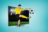 Football player kicking ball through tv