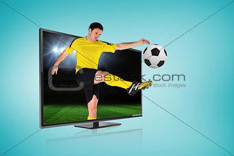 Football player kicking ball through tv
