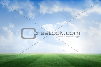 Football pitch under blue sky