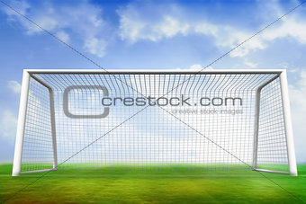 Football pitch and goal under blue sky