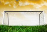 Goalpost on grass under yellow sky