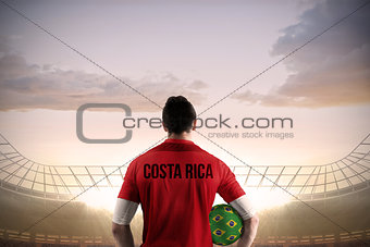 Costa rica football player holding ball