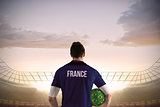 France football player holding ball