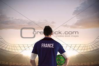 France football player holding ball