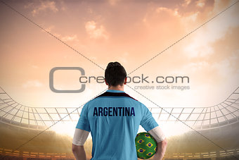 Argentina football player holding ball
