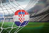 Football in croatia colours at back of net