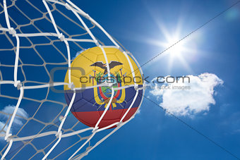 Football in ecuador colours at back of net