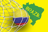 Football in colombia colours at back of net