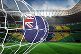 Football in australia colours at back of net