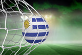 Football in uruguay colours at back of net