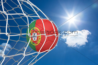 Football in portugal colours at back of net