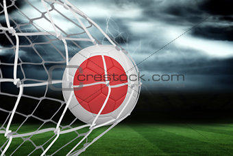 Football in japan colours at back of net