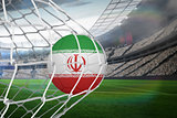 Football in iran colours at back of net