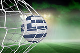 Football in greece colours at back of net