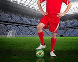 Football player standing with brasil ball