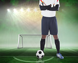 Goalkeeper standing with ball