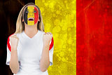 Excited belgium fan in face paint cheering