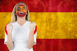 Excited spain fan in face paint cheering