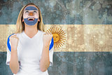 Excited argentina fan in face paint cheering