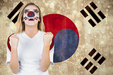 Excited south korea fan in face paint cheering