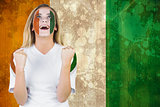 Excited ivory coast fan in face paint cheering