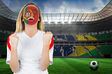 Excited portugal fan in face paint cheering